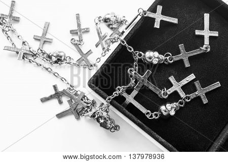 Silver chain with crosses and skulls in black jewel box
