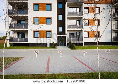 New block of apartment buildings stand in uninhabited suburb.
