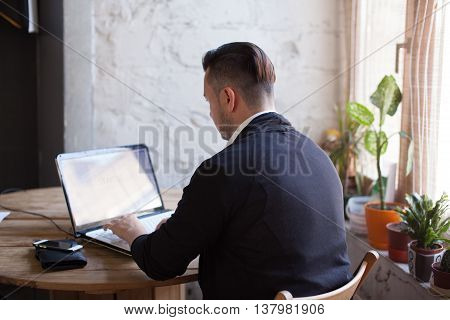 Trendy Man Working In Startup Office