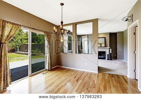 Hallway With Hardwood Floor Connected To Living Room.