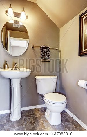 Small Bathroom Interior With Tile Floor And Mirror