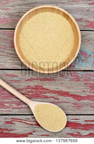 Amaranth seeds in a bamboo bowl on wooden background
