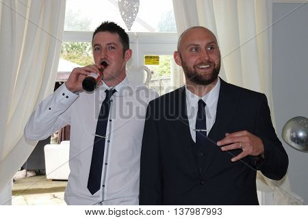 2ND JULY 2016,PORTSMOUTH,ENGLAND: Two smartly dressed englishmen celebrating a marraige of friends in portsmouth,england,2nd july 2016