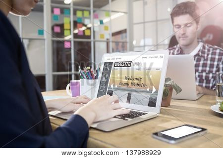 Composite image of build website interface against business people working at computer desk