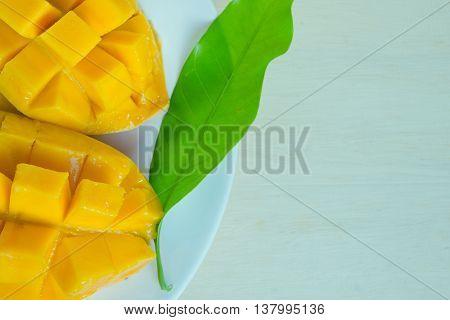 Beautiful nicely cut yellow mango with leaf (Other names are horse mango Mangifera foetida Anacardiaceae Mangifera M. indica)