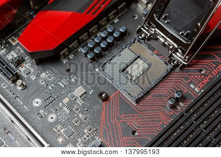 Mainboard with modern interfaces. Black PCB with red lines.
