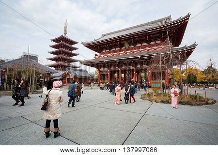 TOKYO - DEC 9: Tourists and sightseers wander around Sensoji Temple in the Asakusa district of Tokyo on December 9, 2013. Sensoji is a famous Buddhist Temple in Tokyo , Japan founded in 628.