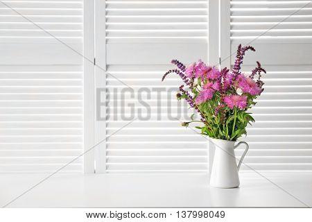 Wild flowers on white folding screen background