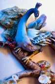 bird sculpture made of porcelain on the background of the canvas art poster