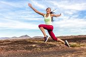 Success freedom carefree runner woman running fun. Happiness, joy, energetic athlete girl happy of weight loss goal achievement jumping funny on summer outdoor trail nature. Fitness motivation. poster