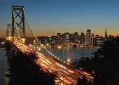 A shot of Bay Bridge and San Francisco skyline from the Yerba Buena Island. poster