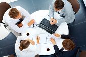 Above view of several business people planning work at round table poster