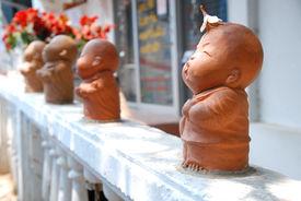 Kid monk statue