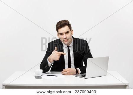 Businessman Sitting At Desk Point Finger At Isolated Laptop Screen , Handsome Young Business Man Loo
