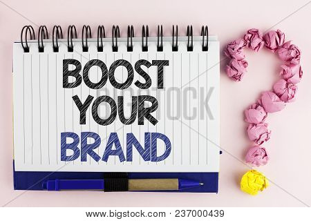 Handwriting text Boost Your Brand. Concept meaning improve your models name in your field overcome competitors written Notebook Book the plain background Pen next to it Ask for. poster