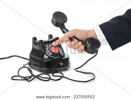 Telephone receiver in hand isolated on white background