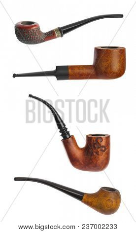 Vintage smoking pipes isolated on white background