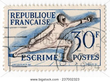 Leeds, England - April 20 2018: An Old Blue French Postage Stamp With An Image Of A Man In A Sword F