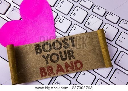 Writing note showing  Boost Your Brand. Business photo showcasing improve your models name in your field overcome competitors written Folded Cardboard Paper Piece placed White Keyboard Heart. poster