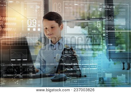 Young Inventor. Clever Enthusiastic Creative Boy Looking Attentively At The Screen Of A Laptop With