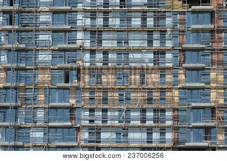 Modern Building With Scaffolds On It Under Construction