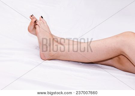 Long Perfect Woman Legs On White Bed