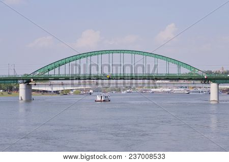 Metal Bridge On The River With The Boat Under
