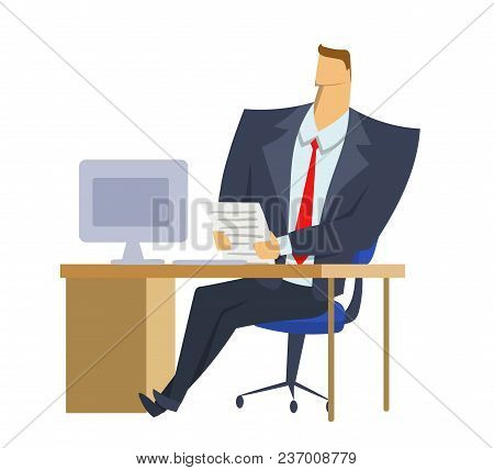 Businessman In Office Suit Sitting In Front Of Computer With Documents In His Hands. Making Decision