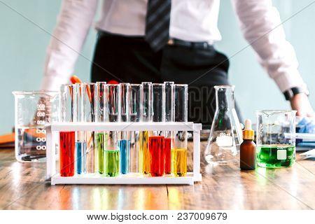 Laboratory Glassware With Male Laboratory Scientist In Science Research Laboratory