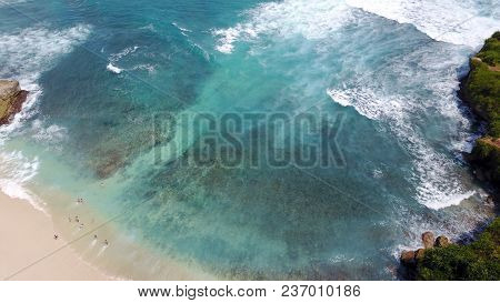 People Swimming In The Ocean On The Beach On The Island Of Penida In Indonesia