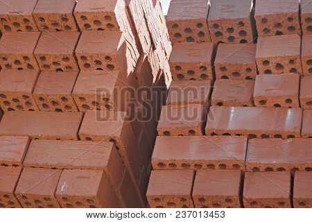 Red Brick In Piles At The Factory Prepared For Shipment