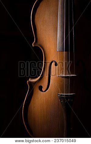 Detail Of Artisan Violin On A Black Background.