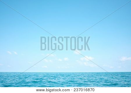 Deep Blue Sea With Water Waves And Horizon Line Against White Fluffy Clouds,deep Blue Sea In The Sou