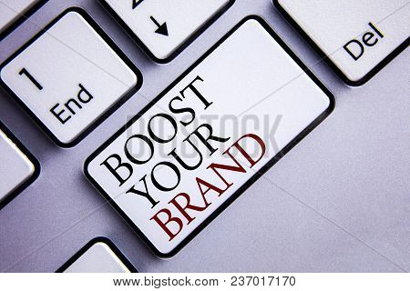 Word Writing Text Boost Your Brand. Business Concept For Improve Your Models Name In Your Field Over