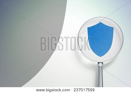 Safety Concept: Magnifying Optical Glass With Shield Icon On Digital Background, Empty Copyspace For