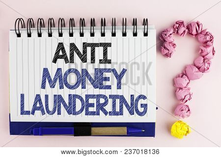 Handwriting Text Anti Monay Laundring. Concept Meaning Entering Projects To Get Away Dirty Money And