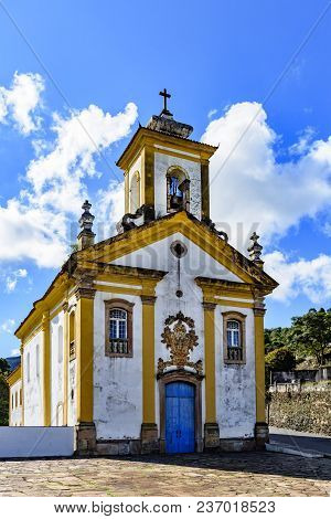 Front View Of Ancient Catholic Church Of The 18th Century Located In The Center Of The Famous And Hi