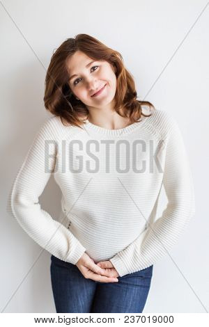 Pregnancy, Tenderness, Harmony Concept. On The White Background There Is Gorgeous Young Woman Who Wi