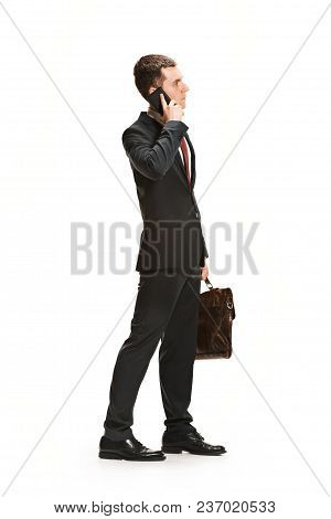 Full Body Or Full-length Profile Of Businessman Or Diplomat With Briefcase On White Studio Backgroun