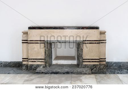 Stone Marble Fireplace On White Wall Background. Fireplace With Beautiful Decorations In Comfortable