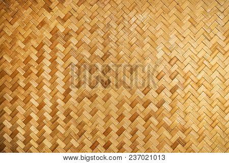 Woven Wood Pattern Background. Yellow Woven Bamboo Wall