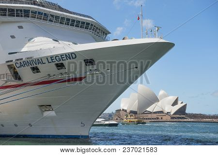 Sydney, Australia - March 24, 2018: Cruise Liner Carnival Legend And Sydney Opera House In The Backg