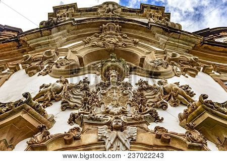 Baroque Style Sculptures And Ornaments On The Front Facade Of A Old And Historic Church In The City