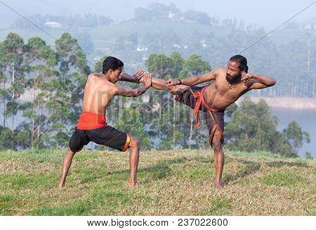 Indian Fighters Performing Adi Thada (hand Combat) During Kalaripayattu Marital Art Demonstration In