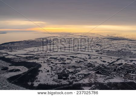 Aerial View To The City In The Kazakh Steppe. During The Evening Sunset. Winter