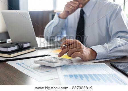Business Financing Accounting Banking Concept, Businessman Doing Finances And Calculate About Cost T