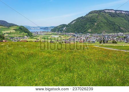 Springtime View From The Foot Of Mt. Stanserhorn In The Swiss Canton Of Nidwalden, Buildings Of The