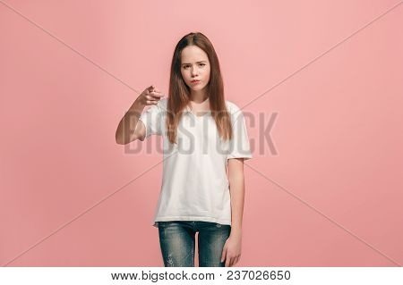 I Choose You And Order. The Teen Girl Pointing To Camera, Half Length Closeup Portrait On Pink Studi