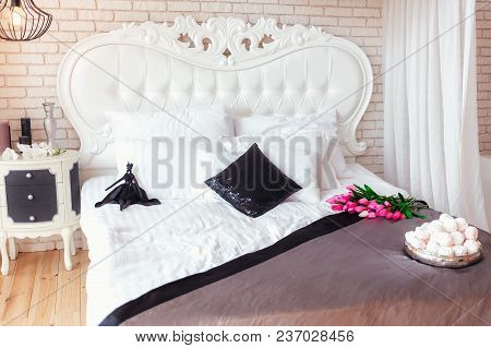 Cozy And Bright Bedroom In Classical Style With White Furniture