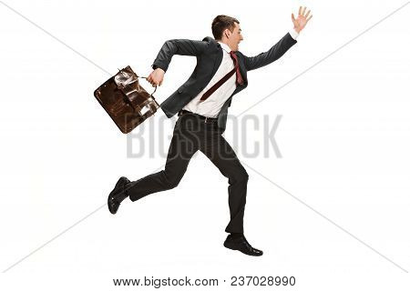 Funny Cheerful Businessman Running Over White Studio Background. Happy Young Man In Suit. Business,
